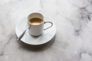Cup of coffee on a marble countertop